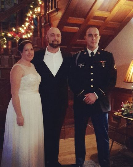 Happy newlyweds and their officiant