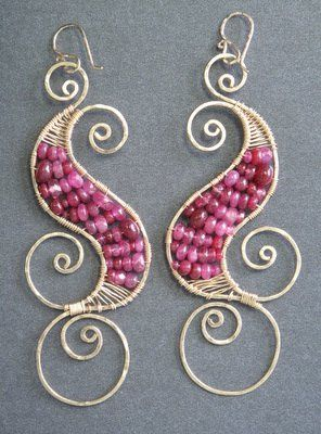 """Hammered swirl shapes wrapped with ruby, about 3-1/4"""".   Available in 14k gold filled & sterling..."""