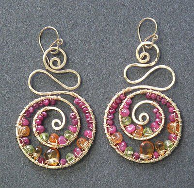 """Hammered swirl shapes wrapped with ruby, citrine, mandarin garnet, peridot, about 2-3/4""""...."""