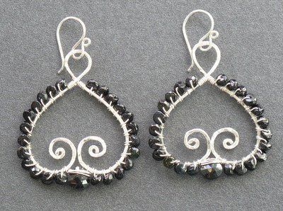 """Hammered swirly drops wrapped with black spinel, about 1-1/2"""" long.   Available in 14k gold filled &..."""