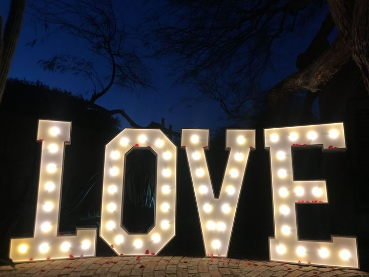 Light up marquee LOVE letters. Personalize these letters with flowers, or any accessories