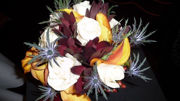 Woodland mix bouquet for white roses, sunset safari, blue thistle, and mango callas