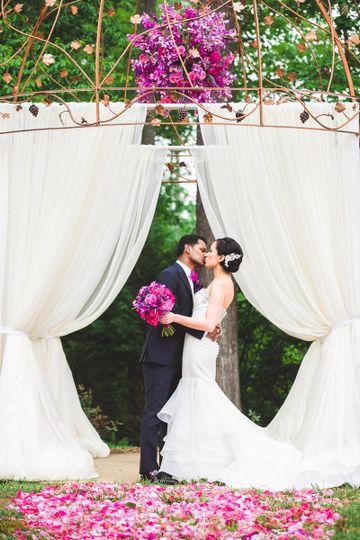 Groom kisses his bride