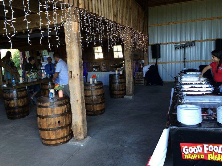 Wedding keg table near the buffet area