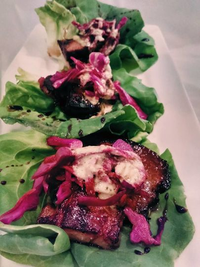 Shoyu Braised Pork Belly with Bibb Lettuce Wraps, Pickled Ginger Red Cabbage & Lime Crema