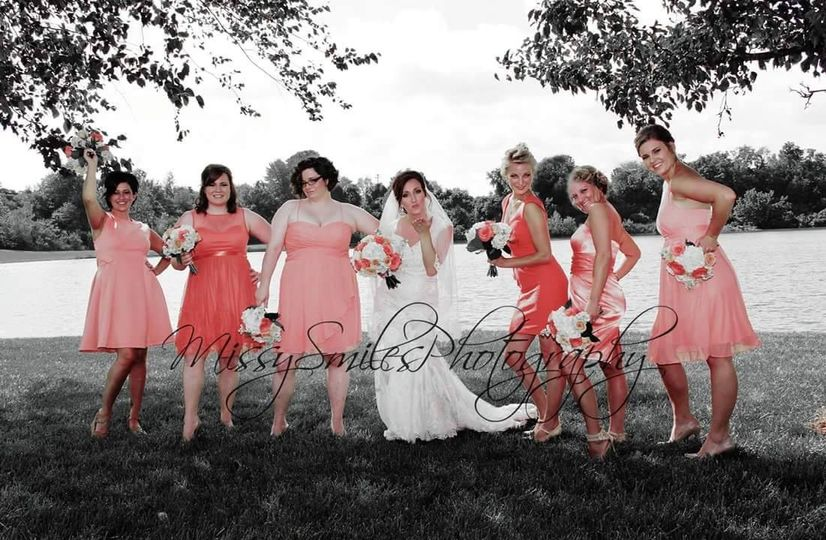 Bride and bridesmaids out by the lake