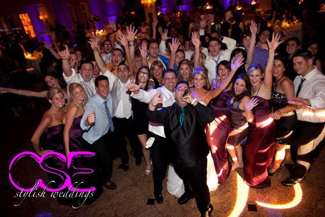 Elizabeth, Frank, their bridal party and Owner of City Sounds Entertainment Jon Hadad, celebrate...