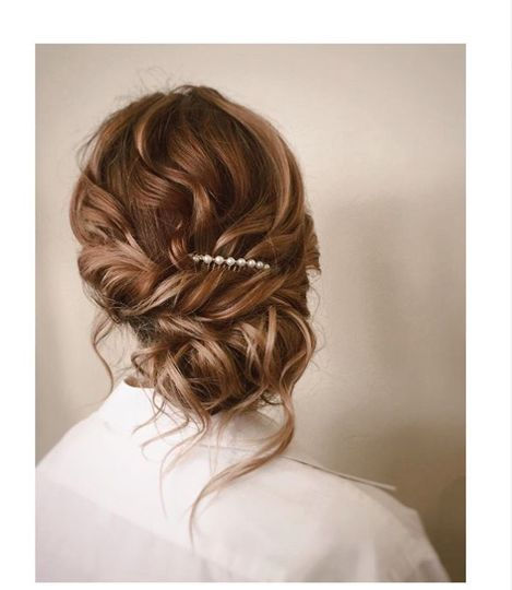 Bridal updo with elegant pin