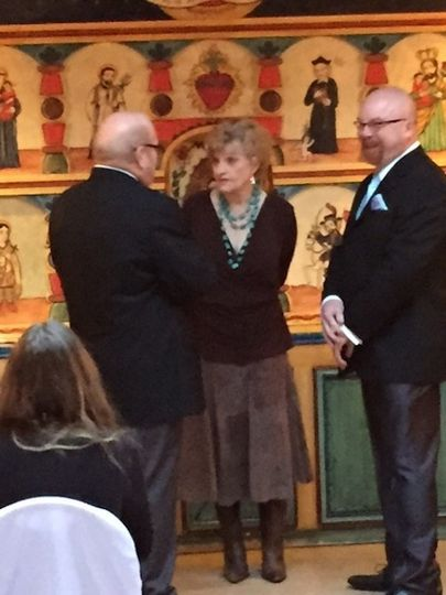 Suzanne confers with Rick and Franklin before the ceremony.