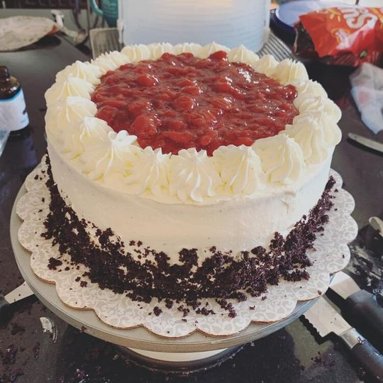 Topped with raspberry preserves