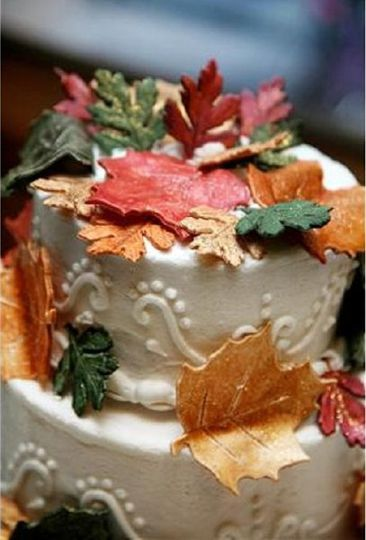 Close up of fall theme cake with edible leaves