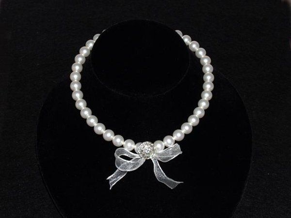 Zara Necklace - The Zara necklace is made of Swarovski pearls strung on a ribbon with a beautiful...