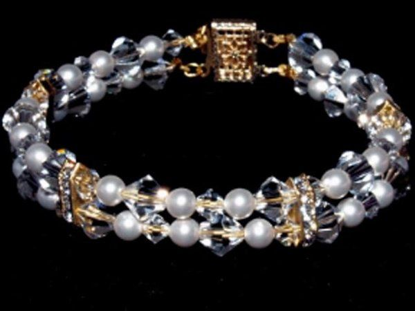 Aurora Bracelet - The Aurora bracelet has two strands made of Swarovski crystals, pearls and...