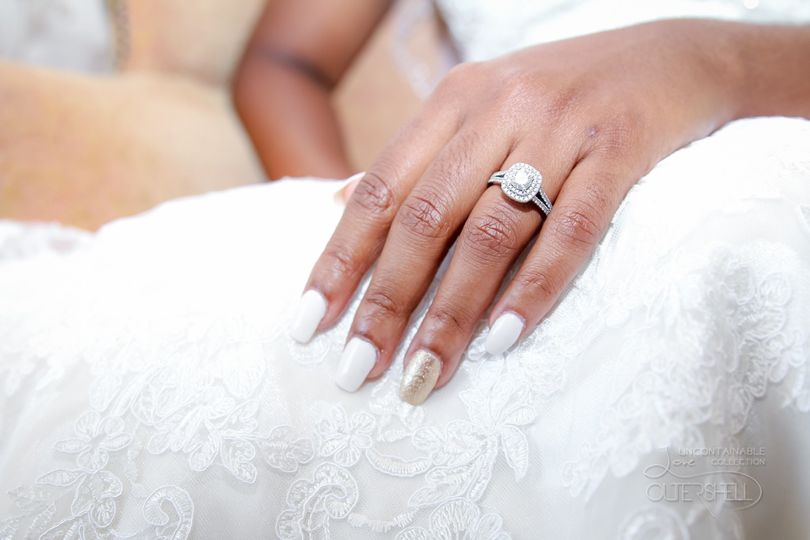 The ring against the lacy dress
