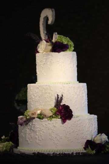 """Customized lighting and decor to create an elegant ambiance, including a """"cake spot"""" specifically..."""