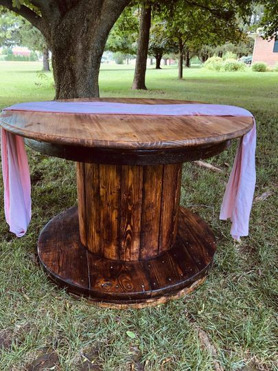 Round wood cake table