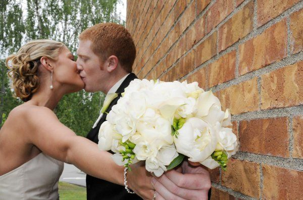 Jenna's classic taste was beautifully displayed in this hand-tied bouquet of white peonies, mini...