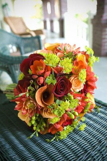 Allie's August wedding was brought to life with a color palate of orange, red and bright green.  Her...