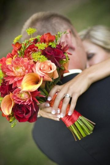 Allie's textured bouquet consisted of mini callas, roses, dahlias, freesia, hypericum berries and...