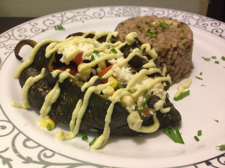 Stuffed Pablano Pepper filled with Black Beans, Rice, Queso Fresco, Tomato, & Avocado Creme