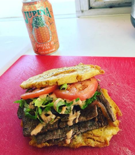 Jibarito, grilled steak, caramelized onions, lettuce, tomatoes and Melecio Sauce between two large...