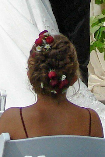 Burgundy spray roses & white monte  entwined in a fancy hairdo.