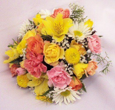 Bridesmaid bouquet in yellow, pink, & white blooms.