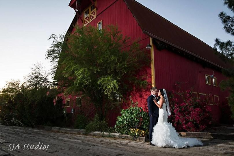Newlyweds outside the barn