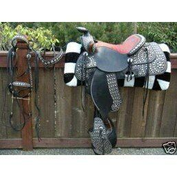 This is an antique Bona Allen parade saddle! It looks stunning our white horses! This saddle is...