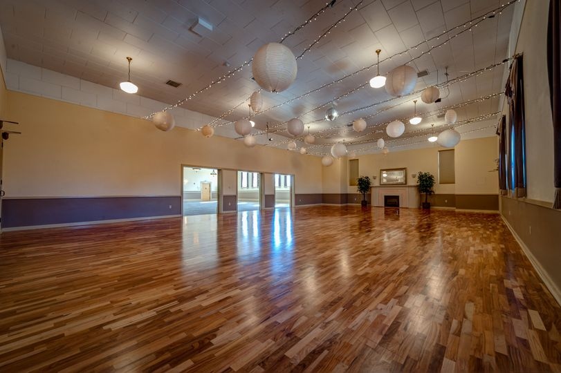 With the Ballroom's high ceilings, shimmering lights, hardwood floor, and neutral palette, it...
