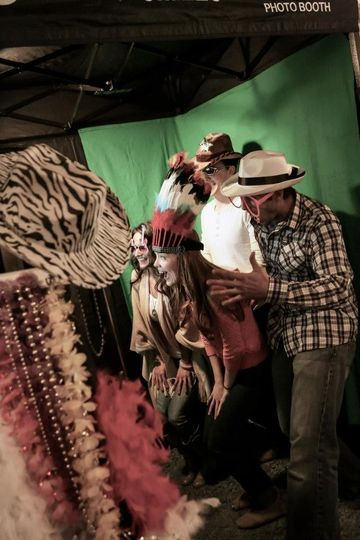 Having fun in the photo booth!  Our booth can fit up to 12 people!  We have a green screen photo...