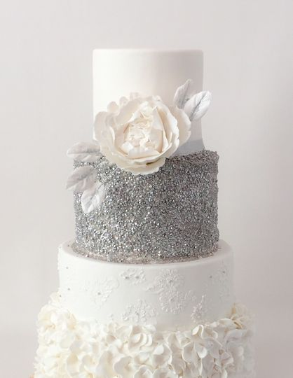 Ruffled four tired cake with edible sequins