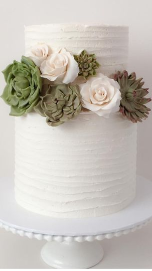 Buttercream cake with edible succulents and roses.