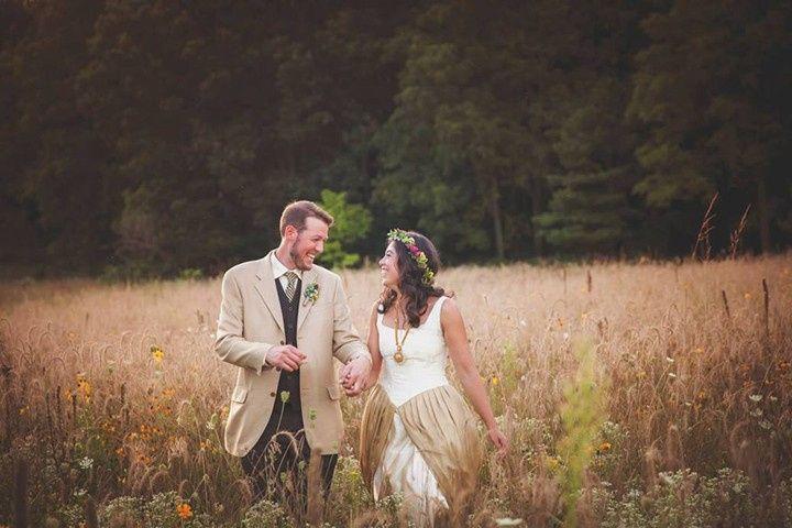 Bride & groom in prairie