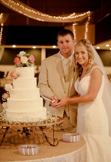 Beautiful couple with their wedding cake.