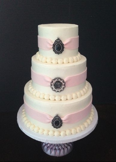 3-tier wedding cake with pink details