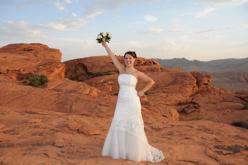 A happy bride surrounded by the beauty of the red rock formation of the Valley of Fire