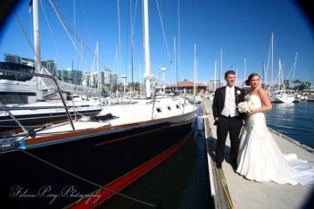 Newlyweds pose by the boat