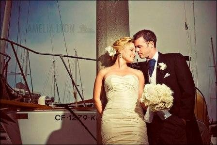 Couple posing by a boat