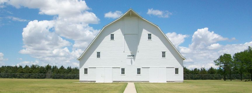 Known as an 8th Wonder of Kansas Architecture, the Prairie Museum of Art & History's Cooper Barn is...