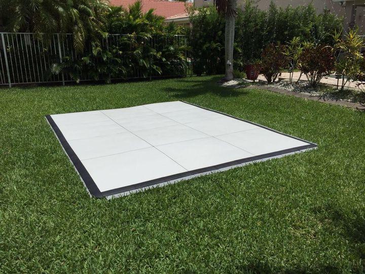 Dance floor set up on grass. White slate design.