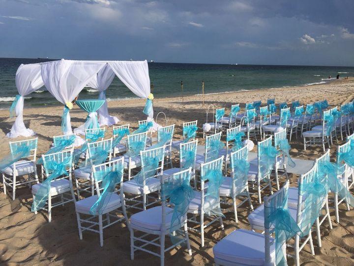 Beach wedding set up. White chiavari chairs and Chuppah.