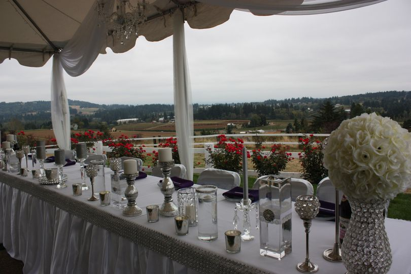 Table setup with candle and flower centerpiece