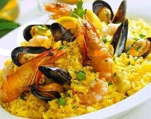 Seafood paella for family style is delicious and just a beautiful platter