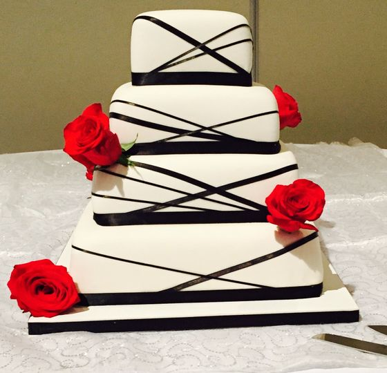 Four tier wedding cake with red flowers