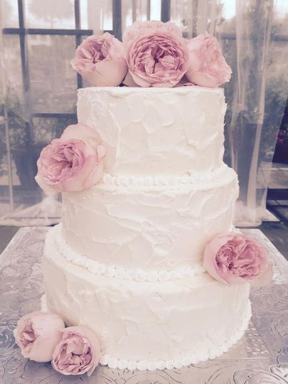 Three tier wedding cake with pink flowers