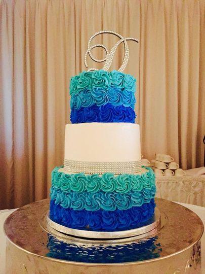 Three tier blue ombre cake