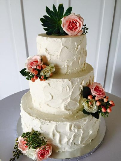 Three tier wedding cake with pink flowers