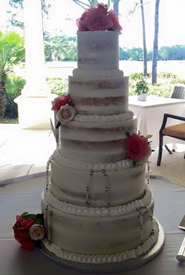 Five tier wedding cake with red roses