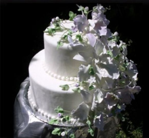 This two layered orchid cake is a timeless classic.  Each hand-made orchid is luster-dusted and...